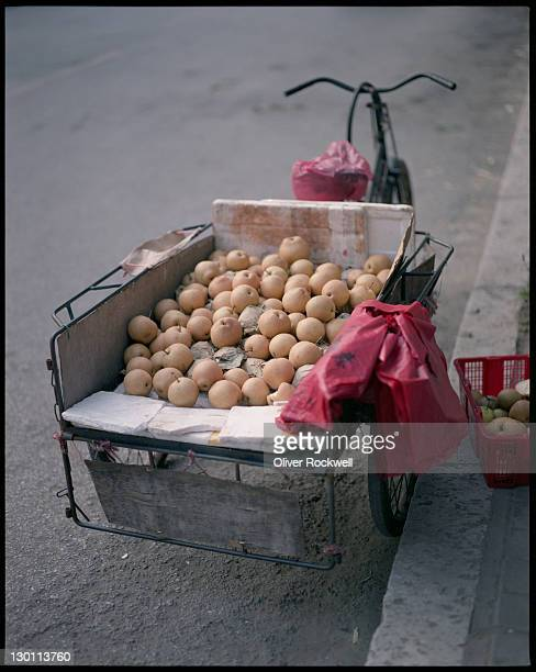 Pear cart with red bag