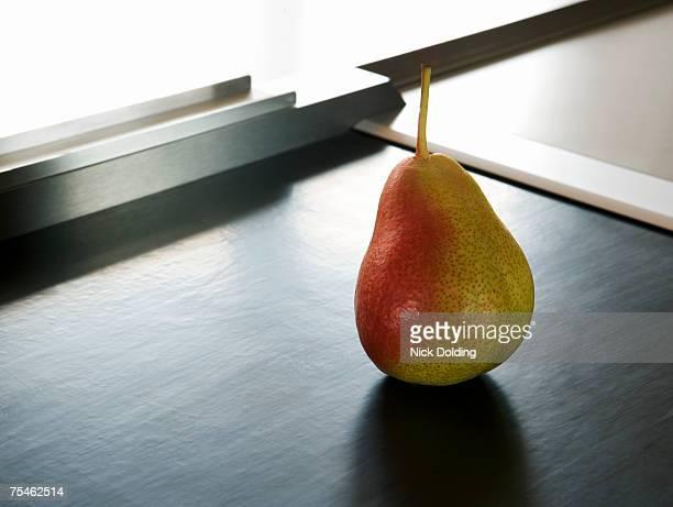 Pear on supermarket conveyor belt