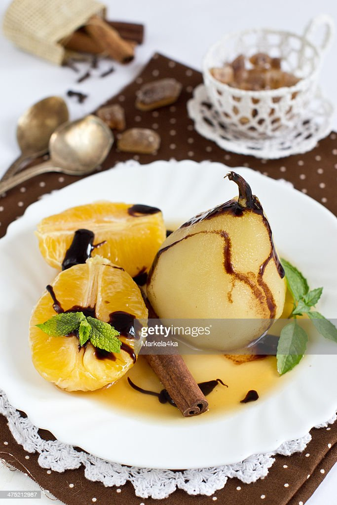 Pear poached in white wine : Stock Photo