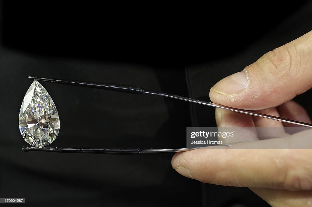 A pear shaped 23.39 ct diamond, G VVS2 with GIA certificate, valued at $2.6 Million USD is shown at Eshed Diam Ltd's stall at the Hong Kong Jewellery and Gem Fair on June 20, 2013 in Hong Kong, Hong Kong. The June Hong Kong Jewellery & Gem Fair runs from June 20 - 23.