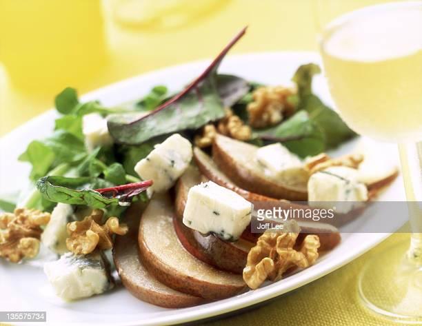 Pear, stilton & walnut salad on white plate