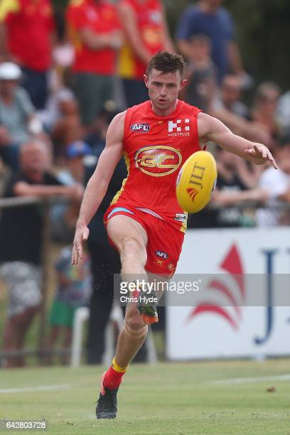 Pearce Hanley of the Suns kicks during the 2017 JLT Community Series match at Broadbeach Sports Centre on February 19 2017 in Gold Coast Australia