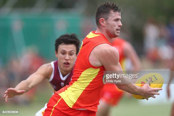 Pearce Hanley of the Suns runs the ball during the 2017 JLT Community Series match at Broadbeach Sports Centre on February 19 2017 in Gold Coast...