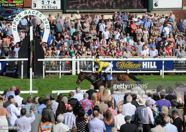 Pearl Acclaim and Harry Bentley win the Ripon Horn Blower Conditions Stakes at Ripon Racecourse North Yorkshire