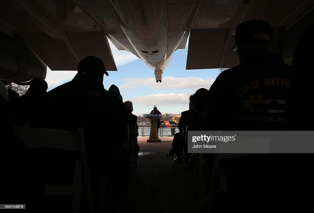 Pearl Harbor survivor Clark Simmons, 92, speaks under the Concorde at in a ceremony marking the 72nd anniversary of the attack on Pearl Harbor, Hawaii on December 7, 2013 in New York City. Four Pearl Harbor survivors from the New York area gathered with former crew members of the USS Intrepid to mark the Japanese surprise attack on December 7, 1941 which killed 2,402 Americans and brought the United States into WWII.