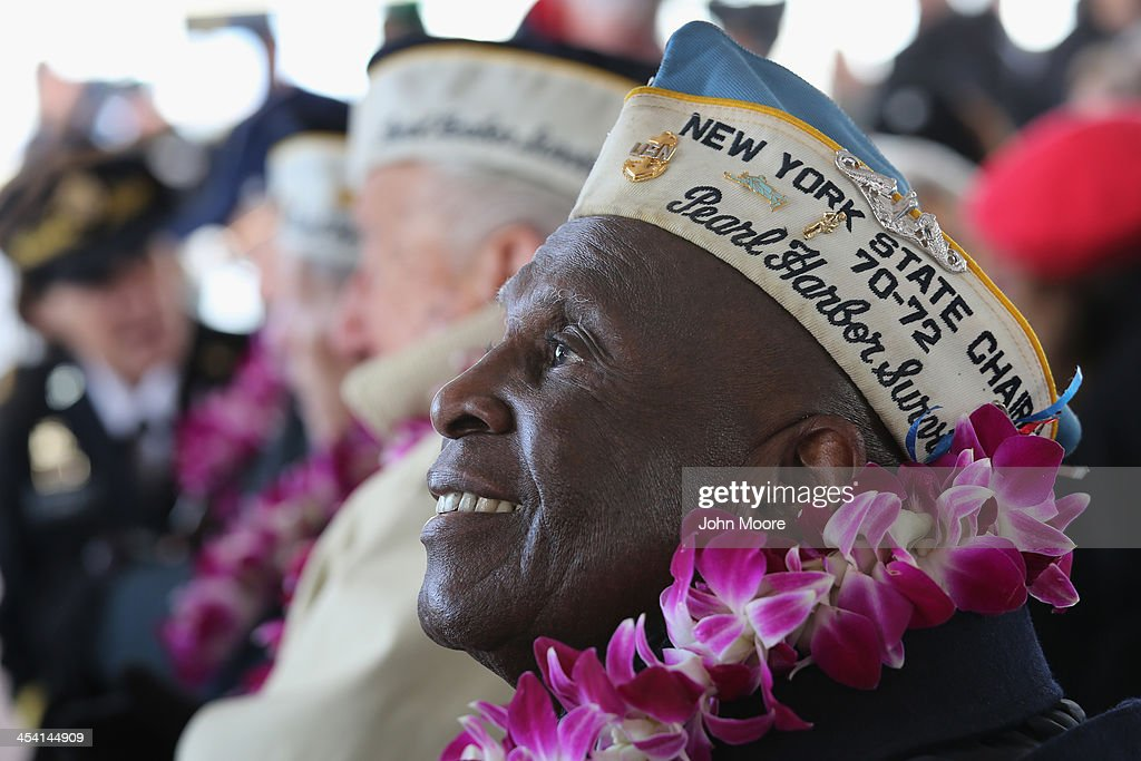 Pearl Harbor survivor Clark Simmons, 92, takes part in a ceremony marking the 72nd anniversary of the attack on December 7, 2013 in New York City. Four Pearl Harbor survivors from the New York area gathered with former crew members of the USS Intrepid to mark the Japanese surprise attack on December 7, 1941 which killed 2,402 Americans and brought the United States into WWII.