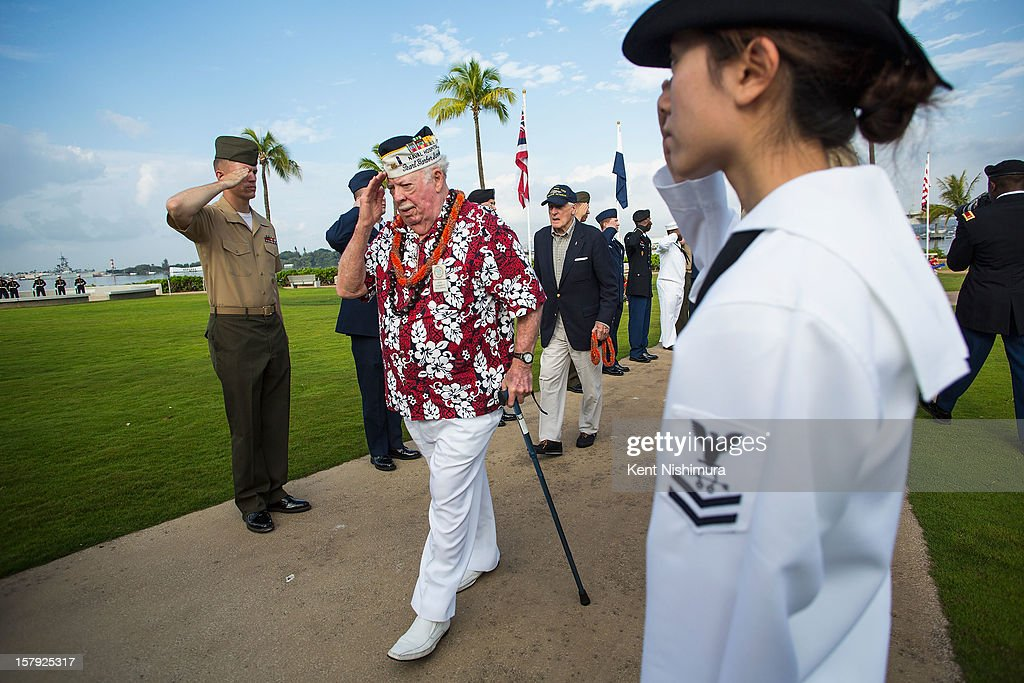 Pearl Harbor survivor Jack Hammett walks along a corridor of military personnel at the 71st Annual Memorial Ceremony commemorating the WWII Attack On Pearl Harbor at the World War 2 Valor in the Pacific National Monument December 7, 2012 in Pearl Harbor, Hawaii. This is the 71st anniversary of the Japanese attack on Pearl Harbor.