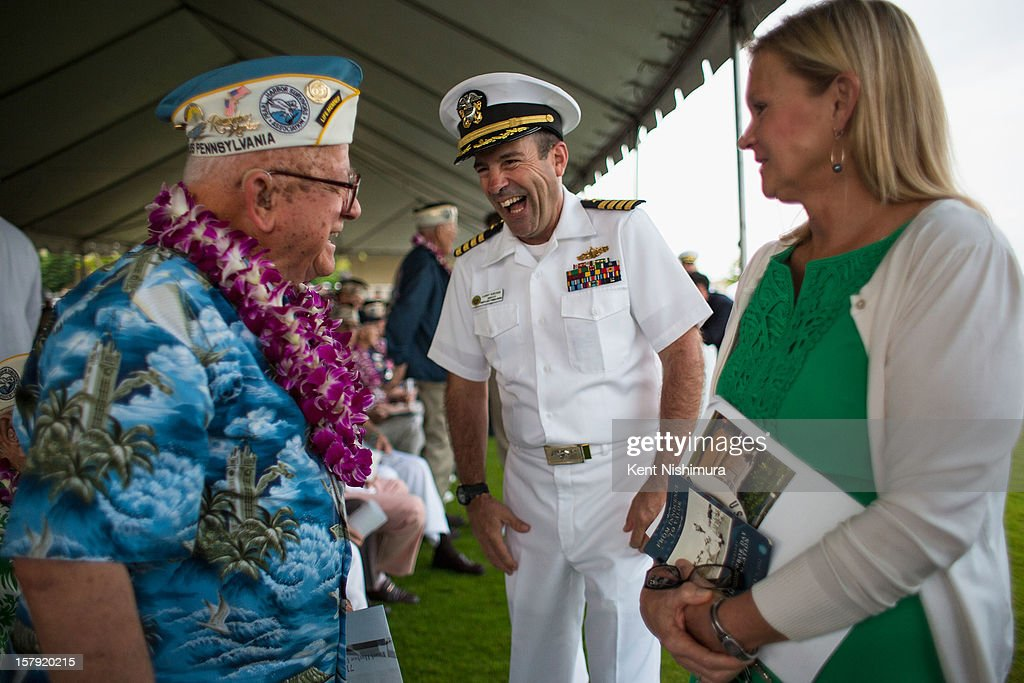 Pearl Harbor survivor Michael Ganitch laughs with Captain Lawrence Scruggs at the 71st Annual Memorial Ceremony commemorating the WWII Attack On Pearl Harbor at the World War 2 Valor in the Pacific National Monument December 7, 2012 in Pearl Harbor, Hawaii. This is the 71st anniversary of the Japanese attack on Pearl Harbor.