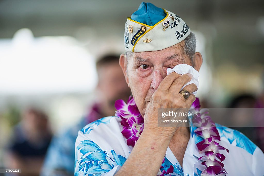 Pearl Harbor survivor Victor Miranda wipes his eyes during the 71st Annual Memorial Ceremony commemorating the WWII Attack On Pearl Harbor at the World War 2 Valor in the Pacific National Monument December 7, 2012 in Pearl Harbor, Hawaii. This is the 71st anniversary of the Japanese attack on Pearl Harbor.