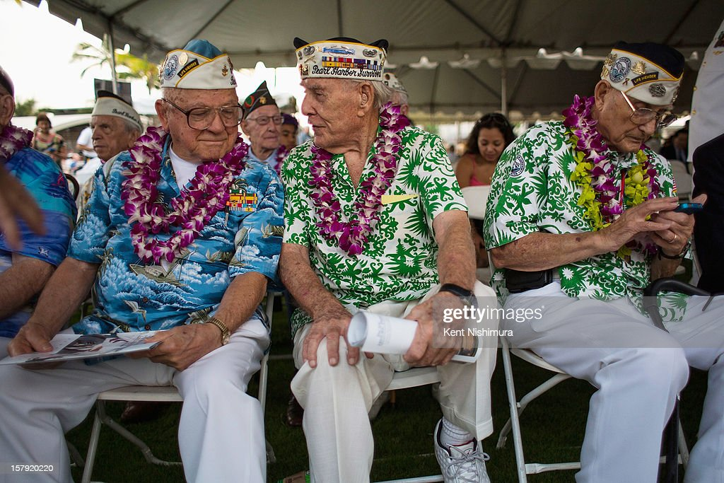 Pearl Harbor survivors Michael Ganitch of California and Robert McCoy of Hawaii talk during the 71st Annual Memorial Ceremony commemorating the WWII Attack On Pearl Harbor at the World War 2 Valor in the Pacific National Monument December 7, 2012 in Pearl Harbor, Hawaii. This is the 71st anniversary of the Japanese attack on Pearl Harbor.