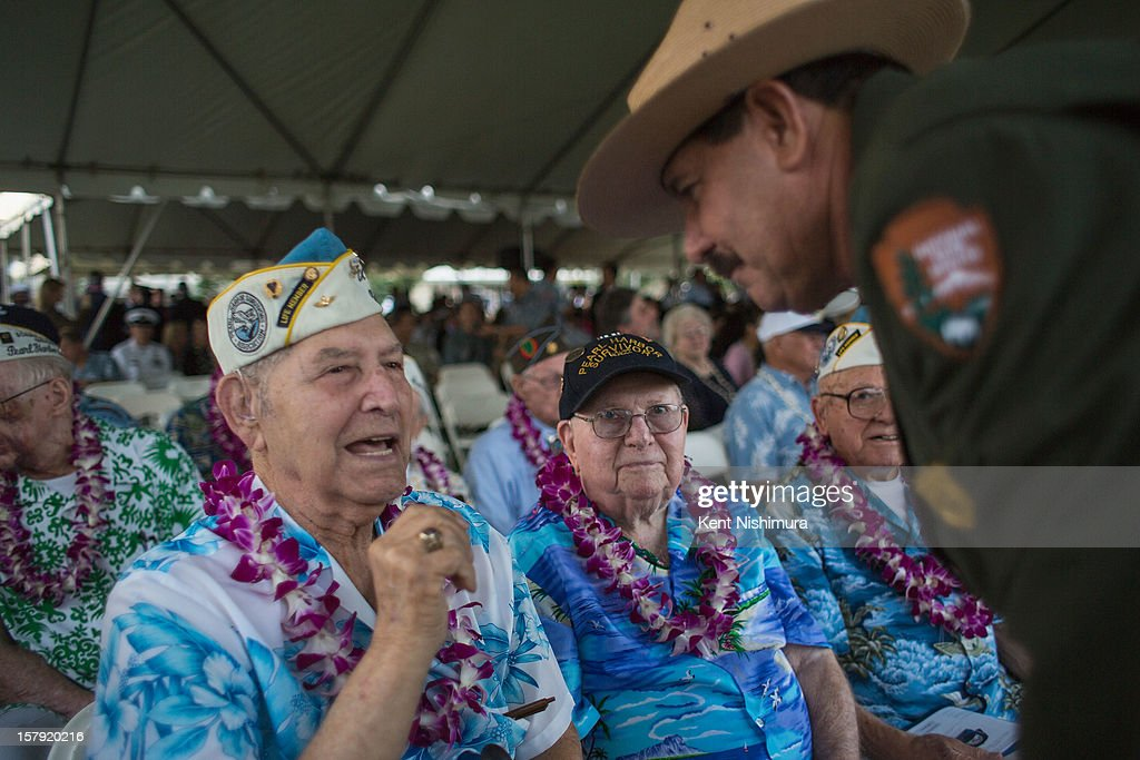 Pearl Harbor survivors Victor Mianda of San Diego, and Paul Kennedy of Indiana speak with National Park Historian Daniel Martinez at the 71st Annual Memorial Ceremony commemorating the WWII Attack On Pearl Harbor at the World War 2 Valor in the Pacific National Monument December 7, 2012 in Pearl Harbor, Hawaii. This is the 71st anniversary of the Japanese attack on Pearl Harbor.
