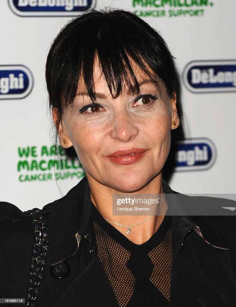 <a gi-track='captionPersonalityLinkClicked' href=/galleries/search?phrase=Pearl+Lowe&family=editorial&specificpeople=211449 ng-click='$event.stopPropagation()'>Pearl Lowe</a> attends the Macmillan De'Longhi Art auction 2013 at Royal Academy of Arts on September 23, 2013 in London, England.