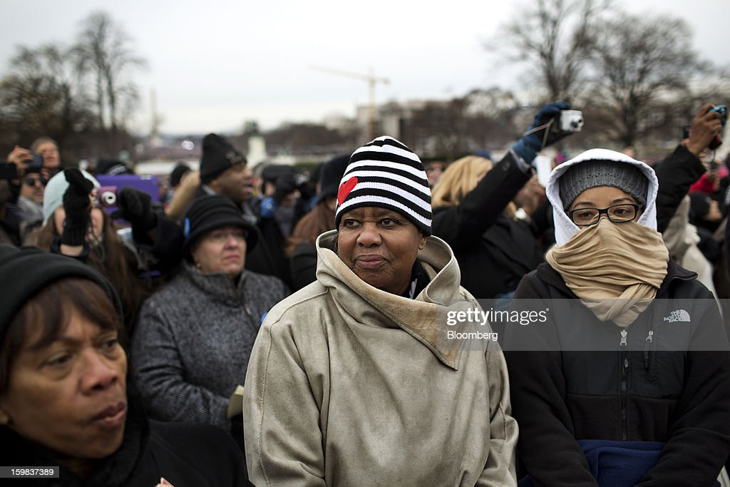 Pearl Mack, of Chicago, center, listens during the U.S. presidential inauguration in Washington, D.C., U.S., on Monday, Jan. 21, 2013. As he enters his second term, President Barack Obama has shed the aura of a hopeful consensus builder determined to break partisan gridlock and adopted a more confrontational stance with Republicans. Photographer: Victor J. Blue/Bloomberg via Getty Images