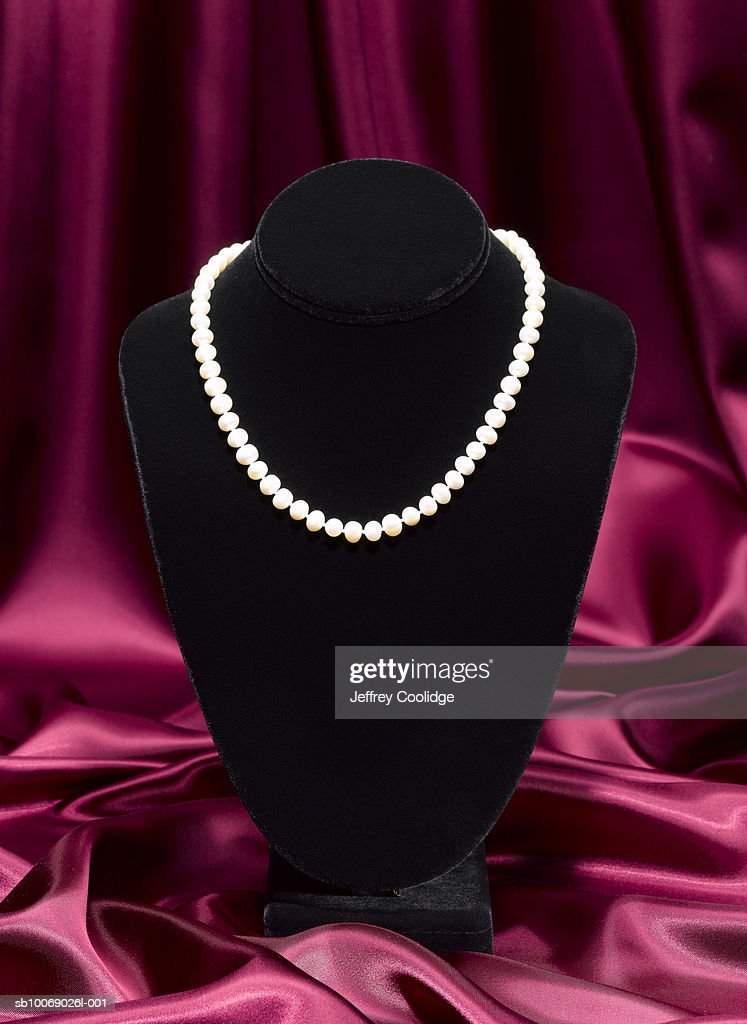 Pearl necklace on jewelry stand, studio shot
