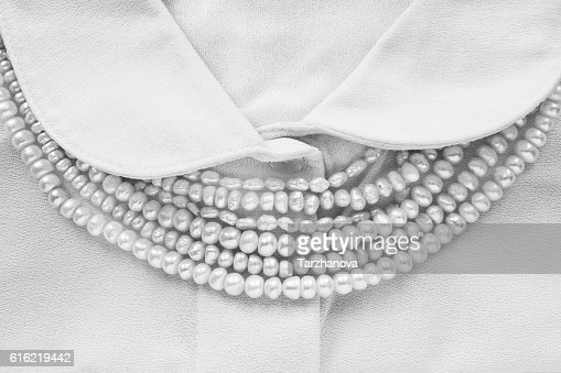 Pearl on blouse : Stock Photo