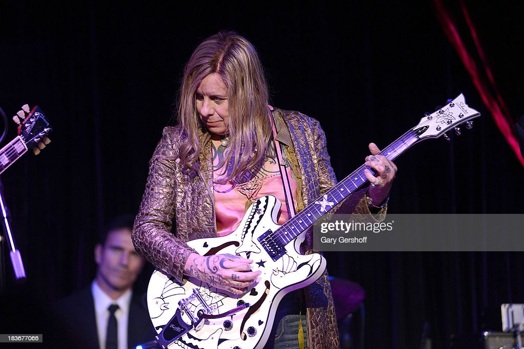 Pearl Thomas formerly Porl Thompson of The Cure performs on stage for the book launch of '108 Rock Star Guitars' benefitting The Les Paul Foundation at The Cutting Room on October 8, 2013 in New York City.