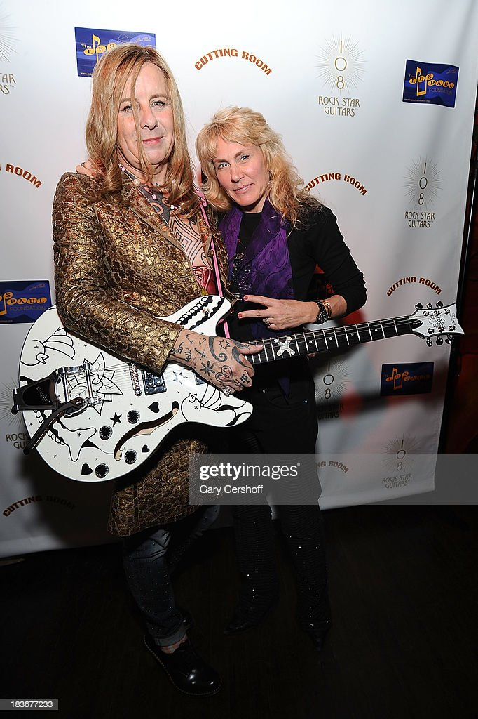 Pearl Thompson, formerly Porl Thompson of The Cure (L) and author and photographer Lisa Johnson attend the book launch and performance for '108 Rock Star Guitars' benefitting The Les Paul Foundation at The Cutting Room on October 8, 2013 in New York City.