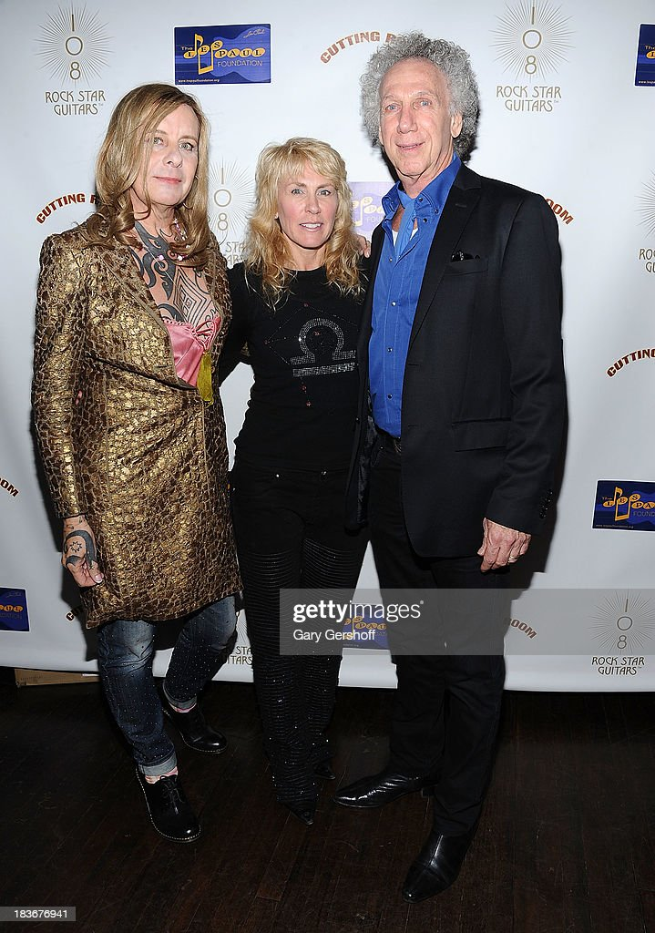 Pearl Thompson formerly Porl Thompson of The Cure, photographer and author Lisa Johnson and photographer Bob Gruen attend the book launch and performance for '108 Rock Star Guitars' benefitting The Les Paul Foundation at The Cutting Room on October 8, 2013 in New York City.