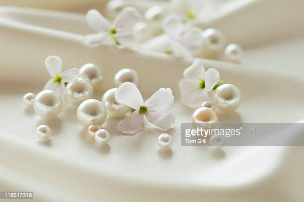 Pearls and flowers on silk