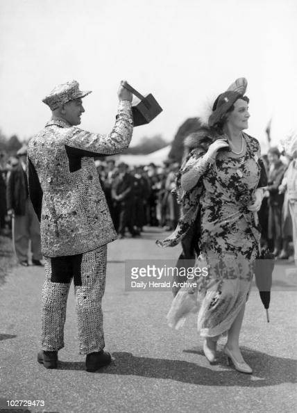 Pearly King collecting money for charity 14 June 1932 A traditional London Pearly King in his suit covered in motherofpearl buttons collects money in...