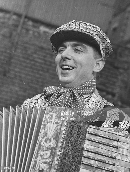 Pearly King or East End costermonger playing an accordion in London Original Publication Picture Post 4811 Pearly Kings And Queens unpub