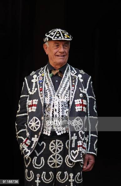 Pearly King poses for a photograph at the Pearly King's and Queen's annual Costermonger's Harvest Festival at the London Guildhall on September 27...
