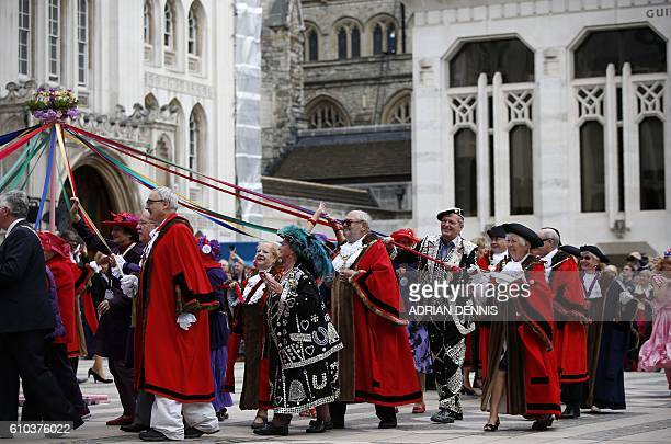Pearly kings and queens dance around a maypole alongside the lord mayors of London in the Guildhall Square part of a parade to celebrate the Pearly...