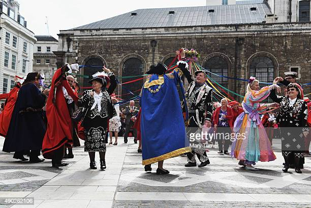Pearly Kings and Queens dance around a maypole with the Mayors of London during the 17th Pearly Kings and Queen's Harvest Festival at The Guildhall...