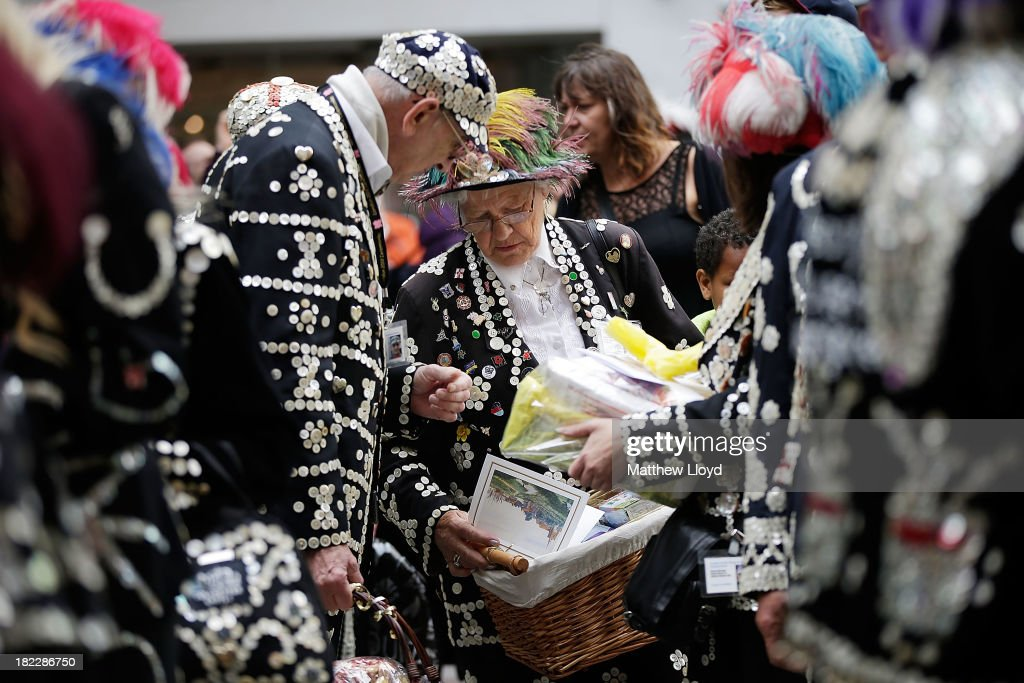 Pearly Kings and Queens gather at St Mary-le-Bow Church bearing charitable donations before a service on September 29, 2013 in London, England. The Harvest Festival features dancing and entertainment by participants in traditional costumes and concludes with a service at St Mary-le-Bow Church, home of the renowned Bow Bells. Dressing as a Pearly King or Queen, by wearing clothes adorned with pearl buttons, originated in the 19th century when London street sweeper Henry Croft decorated his uniform and began collecting money for charity