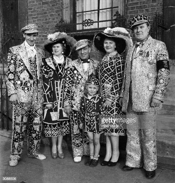 Pearly Kings and Queens or East End costermongers in their traditional suits covered with pearl buttons