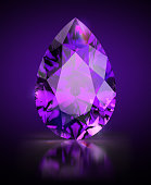 Pear-shaped amethyst on a black reflective background. 3d image.