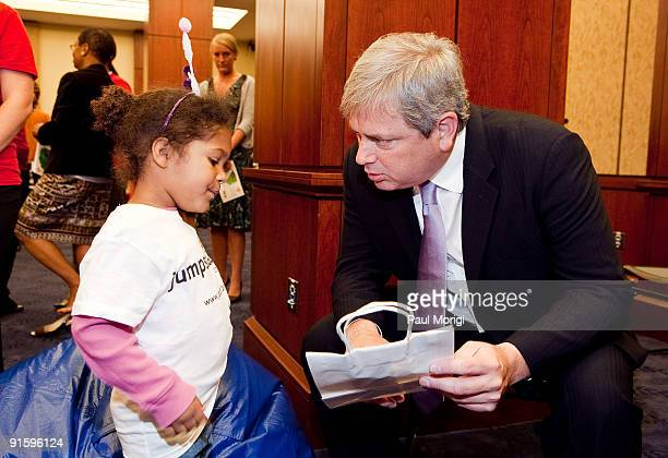 Pearson President Mark Nieker reads to a child at Jump Start's 'Read for the Record' at Capitol Hill on October 8 2009 in Washington DC