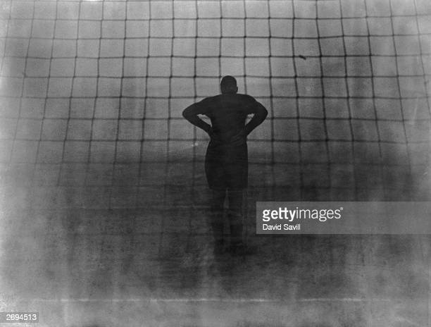 Pearson the Millwall goalkeeper peering into the fog during a semifinal of the London Challenge Cup against Arsenal at the Den