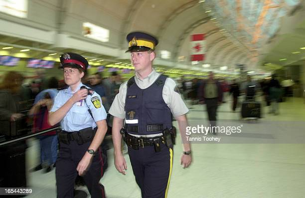 Sept 242001Peel Regional Police constable Tanya Jardine and RCMP Constable Michael LeRoy work foot patrol within the checkin area of the Terminal 3...