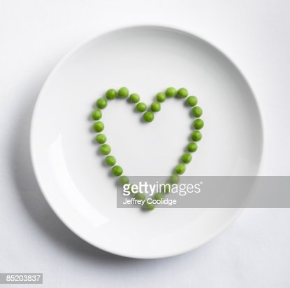 Peas in shape of heart : Stock Photo