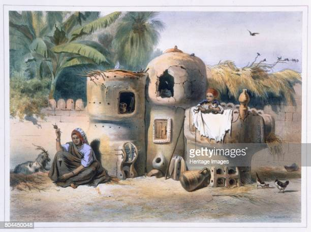 Peasant dwellings in Upper Egypt 1848 From The Valley of the Nile by Emile Prisse d'Avennes Artist Eugene Leroux
