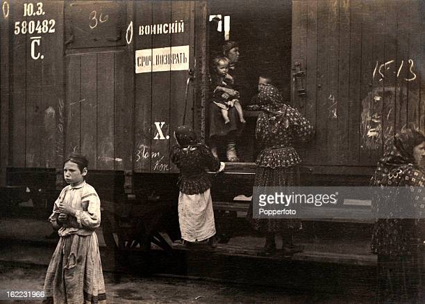 Peasant families boarding railway boxcars at the station in Omsk Siberia on 1st June 1908