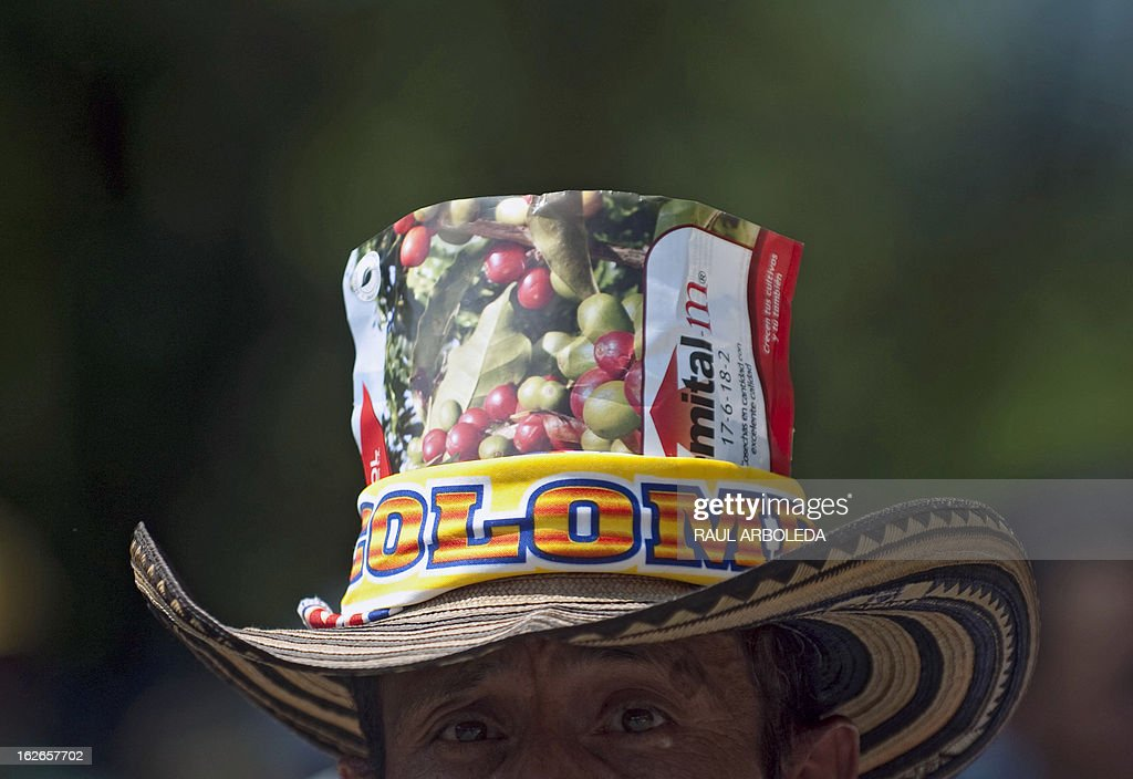 A peasant protests for the difficulties of the coffee sector in Bolombolo municipality, southwest of Medellin, Antioquia department, Colombia on February 25, 2013. Prices and production of coffee have dropped in the last years, informed coffee grower leaders. AFP PHOTO/Raul ARBOLEDA