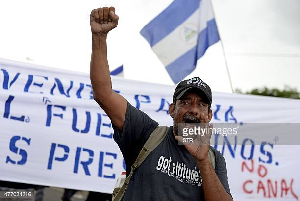 A peasant raises his fist as he shouts slogans during a protest against the construction of an interoceanic canal in Juigalpa Nicaragua on June 13...