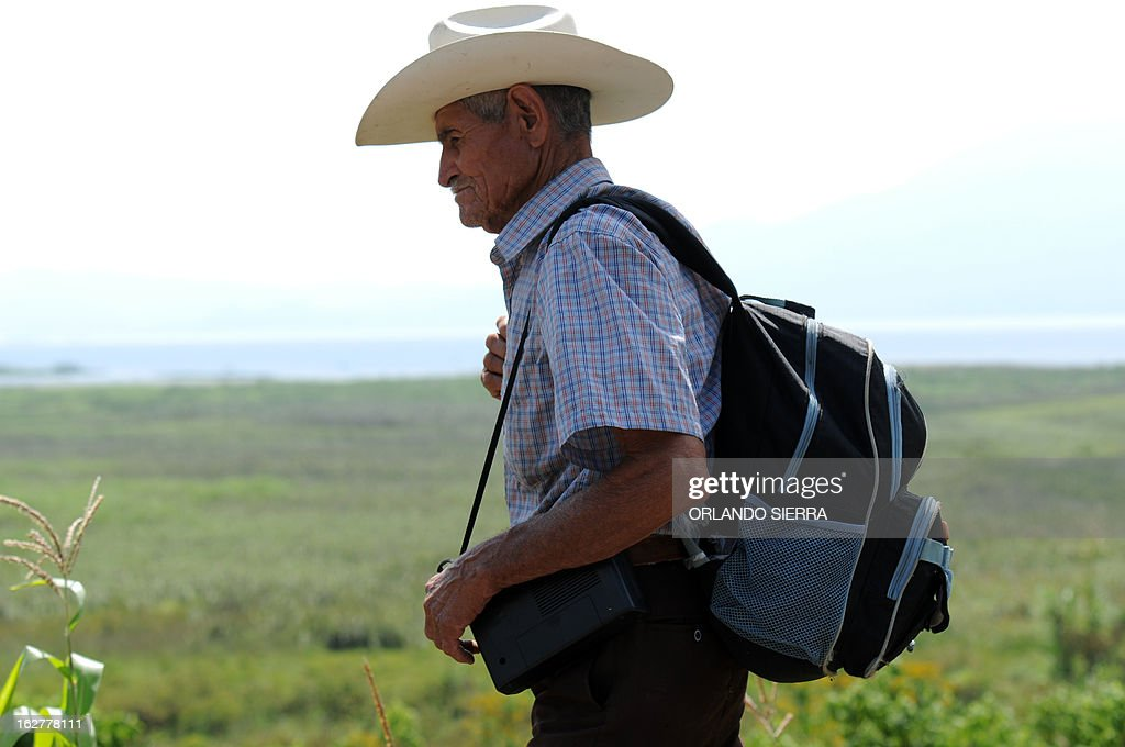 A peasant takes part in a walk towards the Honduran capital to demand the government the abolition of two laws -one promoting mining industry and the other the creation of 'model cities'- in La Guama, 180 km north of Tegucigalpa, on February 26, 13. The peasants would bearriving to Tegucigalpa next March 6. AFP PHOTO/Orlando SIERRA