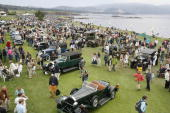 Historic automobiles fill the 18th fairway of the Pebble Beach Golf Links during the 56th annual Pebble Beach Concours d'Elegance 20 August 2006 in...