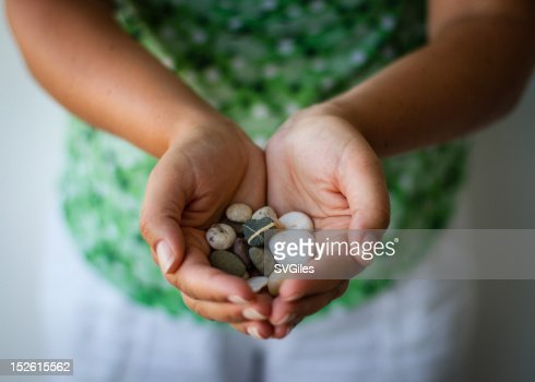 Pebble hands : Stock Photo