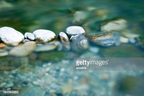 Pebbles and arranged stones in river water