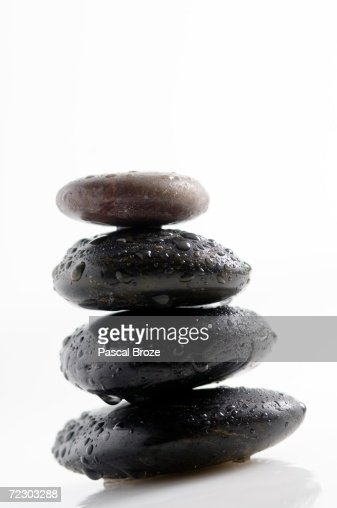 4 pebbles and water drops, close-up : Stock Photo