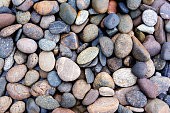 Pebbles background.Gravel background.Colorful pebbles background.