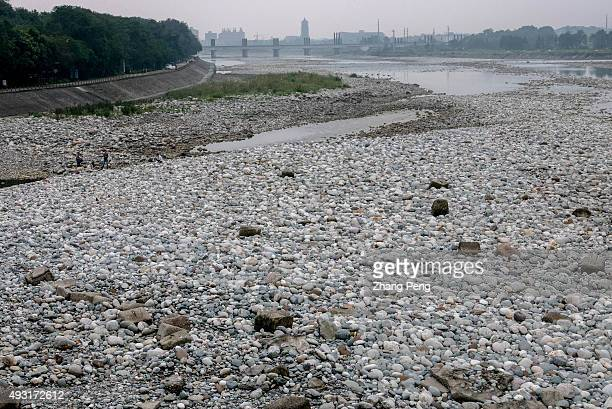 Pebbles on the riverbed of outer stream Most of water are distributed by Dujiangyan system into the inner stream to irrigate over 5300 square...