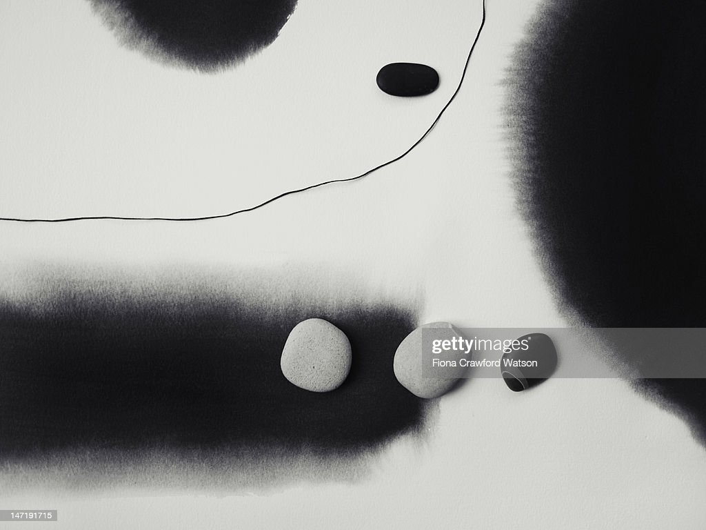 Pebbles on top of minimalist ink painting : Stock Photo