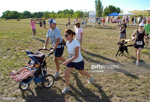 PEBBLESBrian and Maya Shoemaker both 36 from Parker Colorado run with their children Anika and Amelia in the Parker Pebble The 5K crosscountry race...