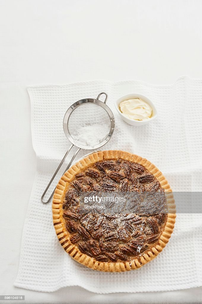 Pecan pie with icing sugar (view from above)