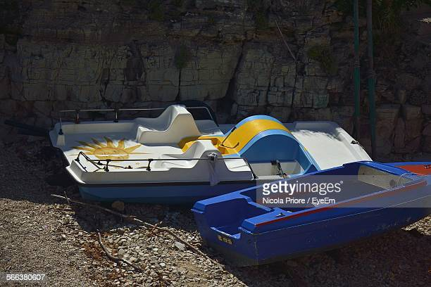 Pedal Boats On Field Against Wall